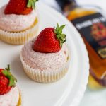 These Strawberry Daiquiri Cupcakes are infused with dark rum, a slap of zingy lime curd at the centre and topped off with sweet strawberry buttercream. | naturallysweetkitchen.com