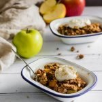 An easy apple crisp recipe that comes together in 15 minutes! A great dessert for two after a weeknight dinner. Get the recipe for this refined sugar free dessert at naturallysweetkitchen.com #quickdessert #easyrecipe #applecrisp #naturallysweetkitchen #refinedsugarfree