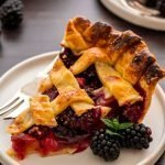 A refined sugar free pie recipe with a flaky all-butter crust and blackberry peach filling.