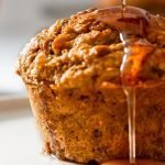 Carrot muffins packed with fibre, vitamins, and protein and naturally sweetened with maple syrup.