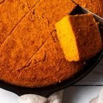 Roasted butternut squash is the star of this cornbread skillet recipe.