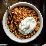 individual refined sugar free rhubarb and ginger crumble topped with greek yoghurt