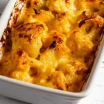 a small-batch cauliflower cheese recipe made with real butternut pumpkin cheddar sauce in a white casserole dish